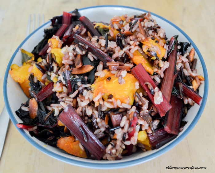 Warm Acorn Squash and Wild Rice Salad with Toasted Almonds, Swiss Chard, and Maple Lemon Dressing