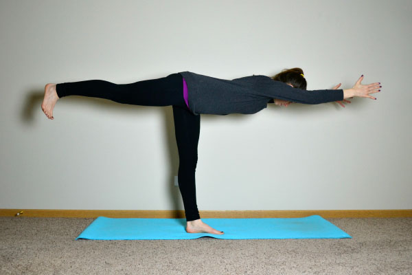 Yoga Poses for Stronger Running Form: Warrior III