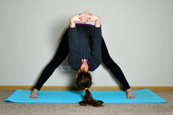 Yoga Poses for Stronger Running Form: Wide Legged Forward Fold